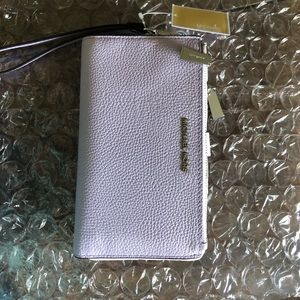 NWT MK wristlet w/pocket for phone